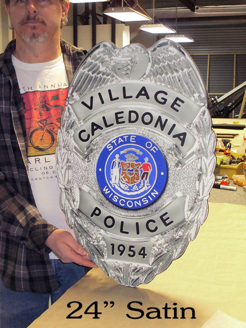 Caledonia PD Badge