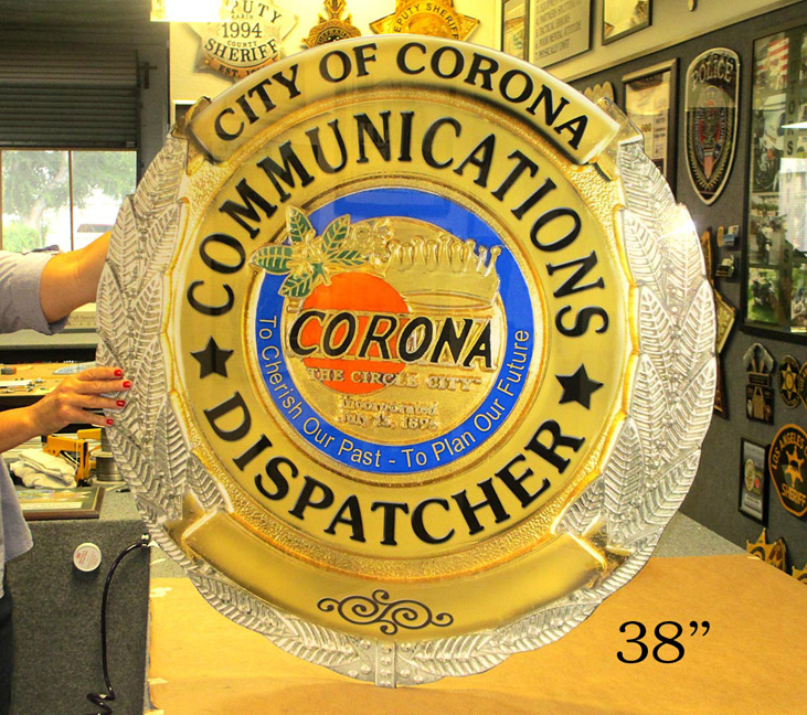 Corona                 Communications Oversize Badge