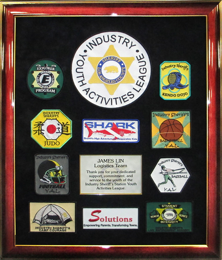 LASD- Youth           Activities League presentation from Badge frame