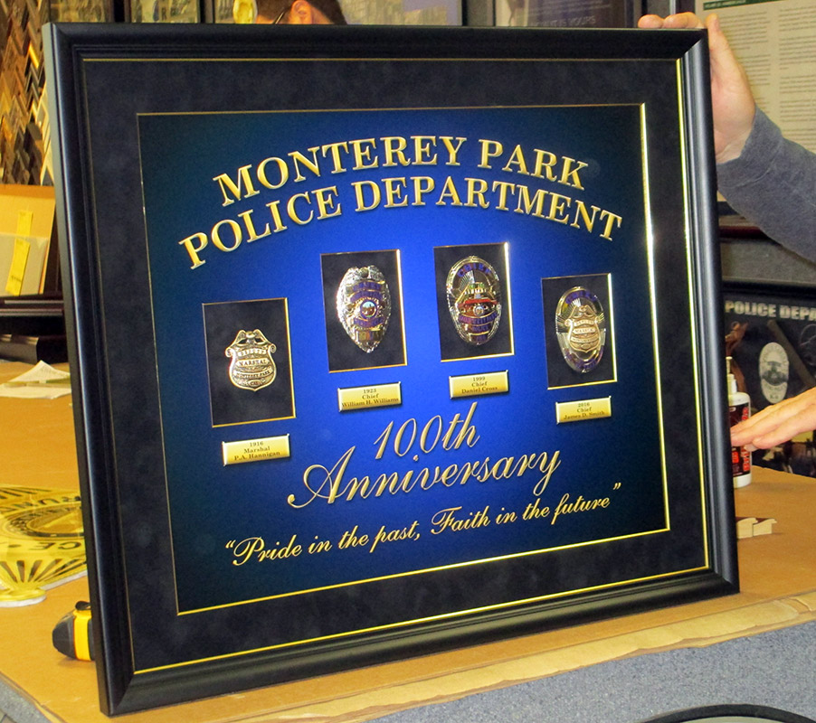 MPPD                             Badge History with printed backboard from                             Badge Frame