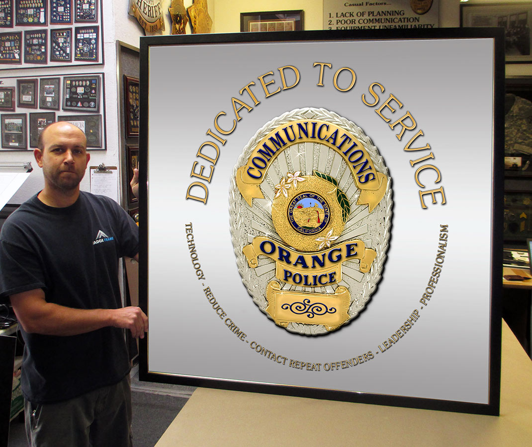 Police Communications sign from Badge Frame framed in Black Leather