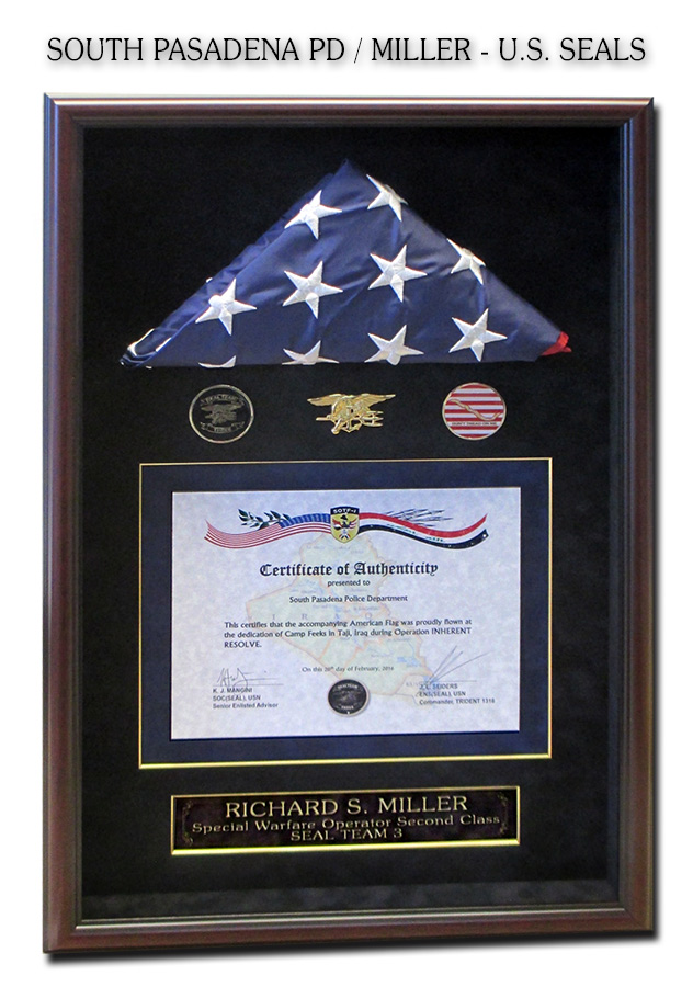 South                             Pasadena PD Flag presentation from Navy Seal                             Richard S. Miller framed by Badge Frame